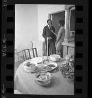 Harriet and Henry Marshall talking as their awaits on table in Los Angeles, Calif., 1968
