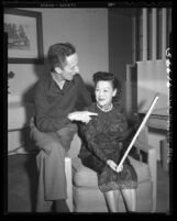 Flora W. Dunn, famed Chinese traditional painter visits with Norman Rockwell, 1949