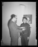 Boy Scout Albert Waterman gets Jewish Ner Tamid award from Rabbi William Kramer in Los Angeles, Calif., 1949