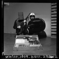 Two Los Angeles police officers modeling anti-riot defense gear, 1967
