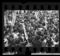 Senator Eugene J. McCarthy making his way through crowd at campaign rally in Los Angeles, Calif., 1968