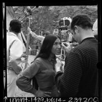 """Native American singer Buffy Sainte-Marie with make-up artist on set of """"The Virginian"""", 1968"""