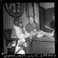Maharishi Mahesh Yogi and Los Angeles Mayor Sam Yorty at press conference, 1968
