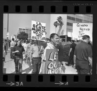 Pickets out front of Los Angeles Police headquarters protesting arrest of Mexican American student leaders, 1968