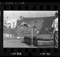High Jumper Dick Fosbury clearing the bar during 1968 Olympic trials at Los Angeles Memorial Coliseum
