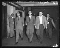 Ben Dobbs, Henry Steinberg and Samuel H. Kashinowitz after being sentenced in Communism investigation, Calif., 1949