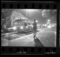 Female USC student waiting for campus trolley, 1968