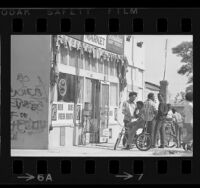 Group of African American boys in front of neighborhood market in Venice, Calif.,1969