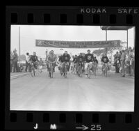 Art Linkletter, Olympian Bob Richards and others on bicycles at start Bob Richards Fitness Crusade, 1969