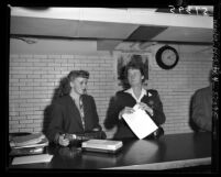 Actress Madge Meredith reporting to Sheriff Dorothy Bowles to begin serving prison sentence in Los Angeles, Calif., 1949