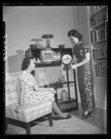 Mrs.Quon shows art object at spring festival and bazaar of the Los Angeles Chinese Woman's Club, 1949