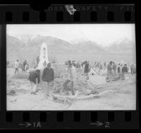 Japanese American Citizens League members clearing ground around Manzanar Shrine at Manzanar War Relocation Center in Calif., 1970