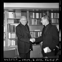 Cardinal James F. McIntyre shaking hands with Timothy J. Manning on day McIntyre retired from Los Angeles Archdiocese, 1970