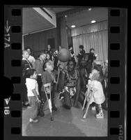"Harlem Globetrotters Harrison Stepter and Bob ""Zorro"" Hunter entertaining children at Los Angeles' Orthopaedic Hospital, 1970"