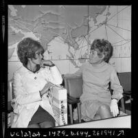 Wives of missing U.S. pilots James L. Hughes and Louis Jones leaving for Vietnam, 1969