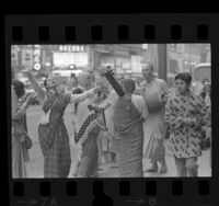 International Society for Krishna Consciousness members dancing and chanting on Broadway Street in Los Angeles, Calif., 1970