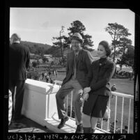 Bing and Kathy Crosby on the terrace of the Del Monte Lodge, Pebble Beach during 29th annual Pro-Am Clambake, 1970