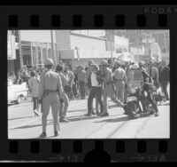 Police restraining UCLA students during Chicago Seven protest march in Westwood, Calif., 1970