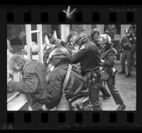 Police arresting students during Chicago Seven protest march in Westwood, Calif., 1970
