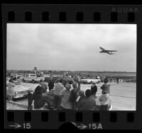 Crowd of people watching a 747 jumbo jet take off at Los Angeles International Airport, 1970