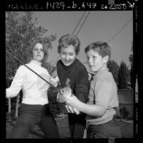 U.S. fencing champion Janice Lee Romary practicing with her children in Los Angeles, Calif., 1968