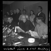 Cesar Chavez, clergy Timothy Manning and Joseph F. Donnelly at press conference announcing grape growers agreement in Calif., 1970
