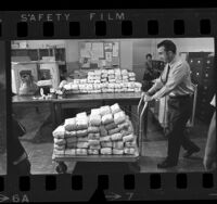 Los Angeles Sheriff's deputy E.D. Rudolph moving illegal drugs seized in Hollywood, Calif., 1970