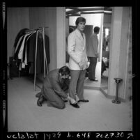 Actor Roger Herren being fitted for a suit in Los Angeles, Calif., 1970