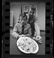 Sheriff deputies displaying LSD laced potato and corn chips in Los Angeles, Calif., 1970