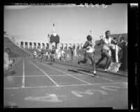Gary Green and Clifton Ivory hit finish at Southern League 440 race at the Coliseum in Los Angeles, Calif., 1949