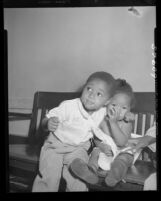 "Ocia Mae Miles and brother Herman at hospital after eating some ""strange bluish powder"" in Los Angeles, Calif., 1949"