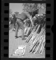USC students picking up picket signs for anti-war march, 1970