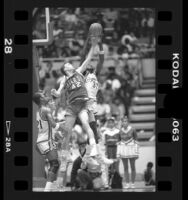 Basketball players Stephen Thompson battling Tom Peabody in Crenshaw High School vs Mater Dei game in Los Angeles, Calif., 1986