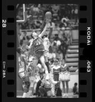Basketball players Stephen Thompson battling Tom Peabody in Crenshaw High School vs Mater Dei game in Los Angeles, Calif., 1986