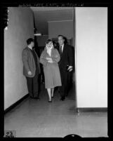 Cheryl Crane with her father Stephen Crane leaving police station in Beverly Hills, Calif., 1958
