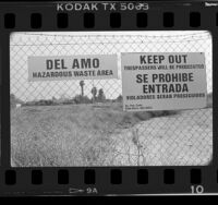 Warning signs on fence at Del Amo hazardous waste site, Torrance (vicinity), 1986