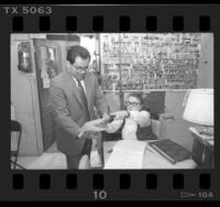 55th Assembly District candidate Richard Polanco filing his absentee ballot in person, Los Angeles, Calif., 1986