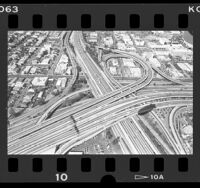 View from dirigible [blimp] of interchange of the Santa Monica and Harbor Freeways in Los Angeles, 1986