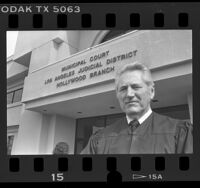 Judge Harold Crowder standing at entrance of Hollywood Branch of Los Angeles Municipal Court, Calif., 1986