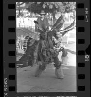 Two men performing the Eagle Dance at dedication of Indian Garden at the El Pueblo State Historic Park in Los Angeles, 1986