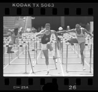 Robert Reading, Kevin Young and Derek Knight racing hurdles in Los Angeles, Calif., 1986