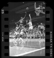 James Worthy going up for basket during Houston Rockets vs Los Angeles Lakers game, 1986