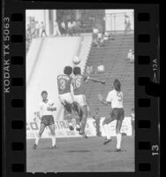 Two Mexican soccer players go up for a header during game against England at Los Angeles Coliseum, Calif., 1986
