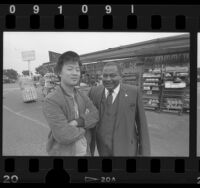 Jin Lee with Reverend Huey Rachal outside Lee's dairy store in Los Angeles, Calif., 1986