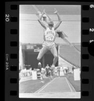 Mike Powell mid-leap in long jump, 1986