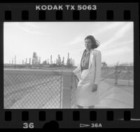 Sabrina Schiller outside Golden West oil refinery in La Mirada, Calif., 1986