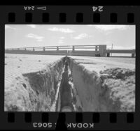 Earthquake damage, 5-inch crack on California Route 111 overpass, Palm Springs (vicinity), 1986