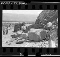 Caltrans crew at work on boulders blocking California 111, Palms Springs (vicinity), 1986