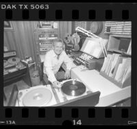 Radio host, Chuck Cecil in his home studio in Los Angeles, Calif., 1986
