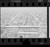 Birds-eye view of construction on Century Freeway overpass on Harbor Freeway, Los Angeles, 1986